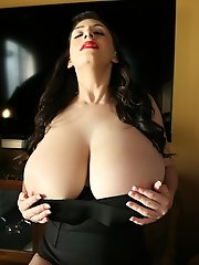 Busty September unleash huge boobs under her corset